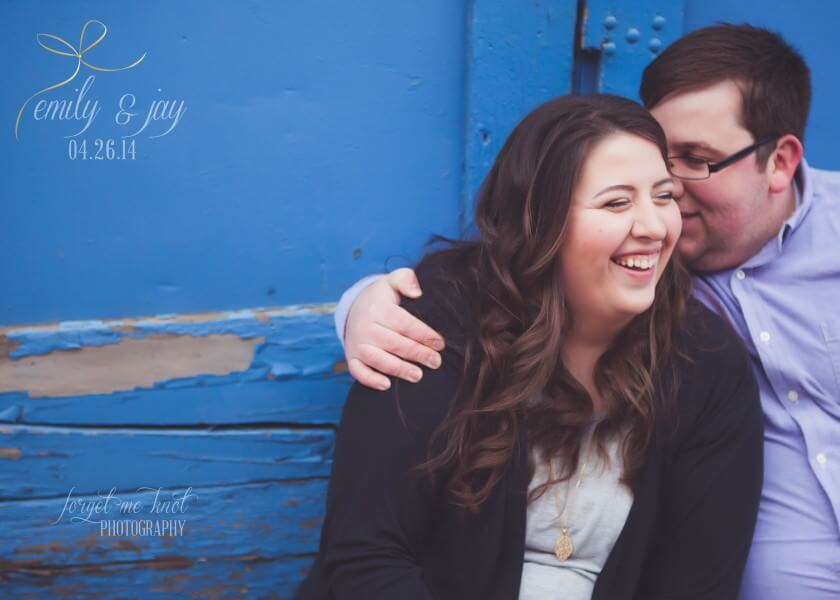 groom to be whispering in brides ear at short north engagement