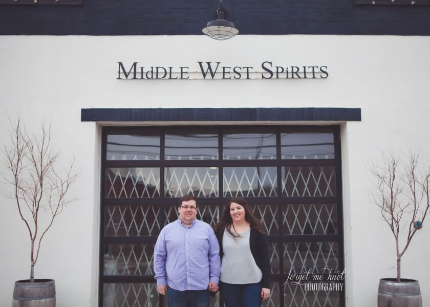 engaged couple in front of middle west spirits