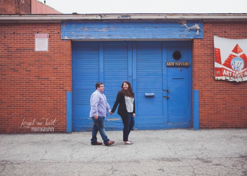 engaged couple walking together at short north engagement