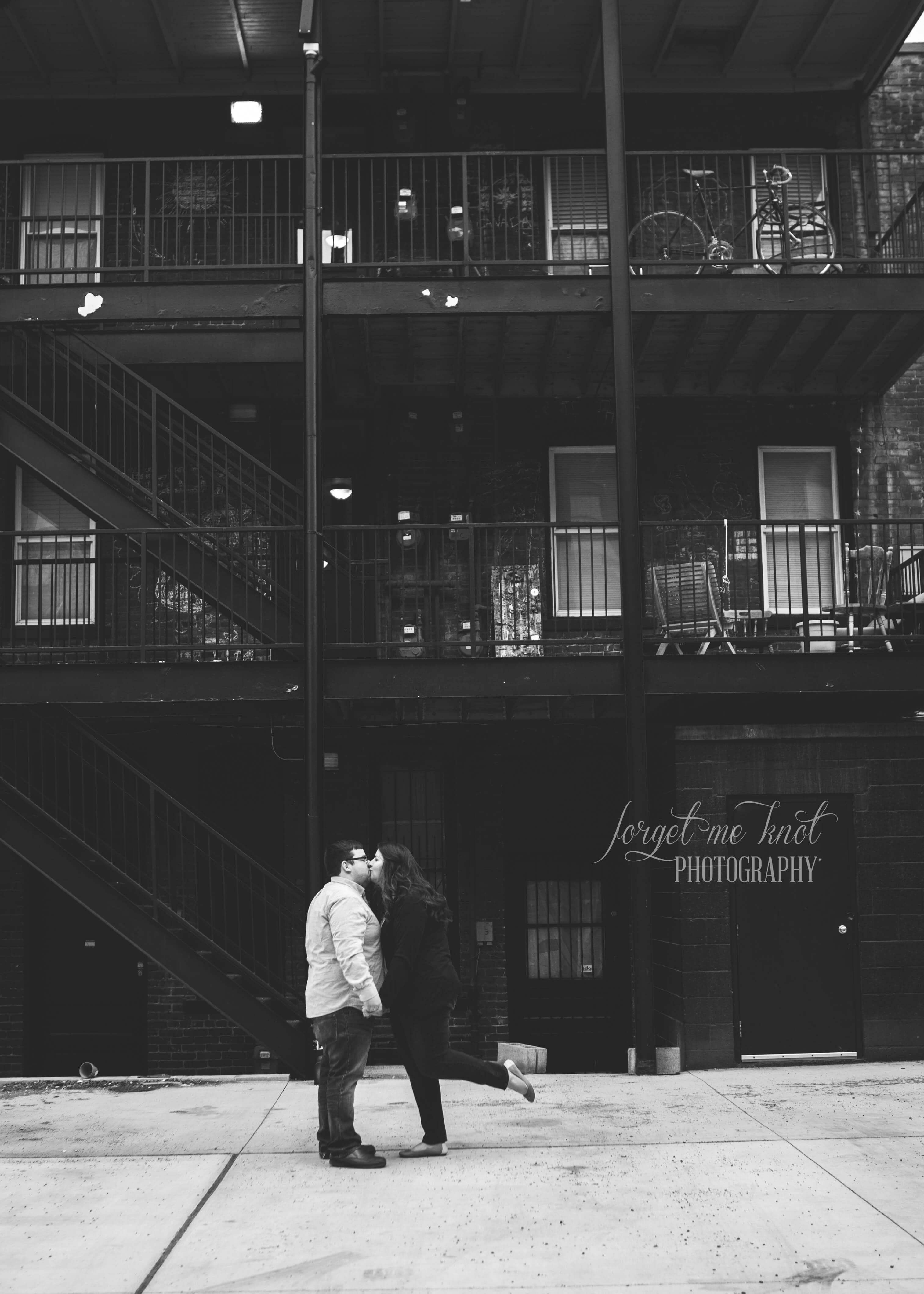 black and white photo of couple kissing at short north engagement