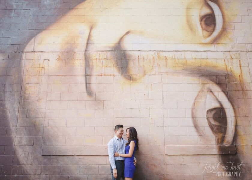wide photo of engaged couple in front of columbus ohio mona lisa mural
