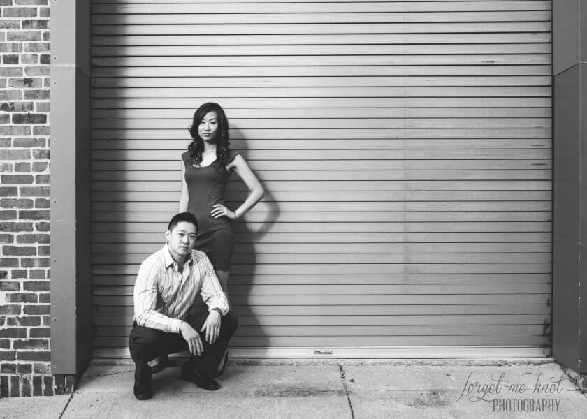 engaged couple in front of garage doors at columbus ohio photography session