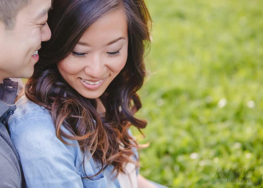 groom to be whispering in brides ear at columbus ohio photography engagement