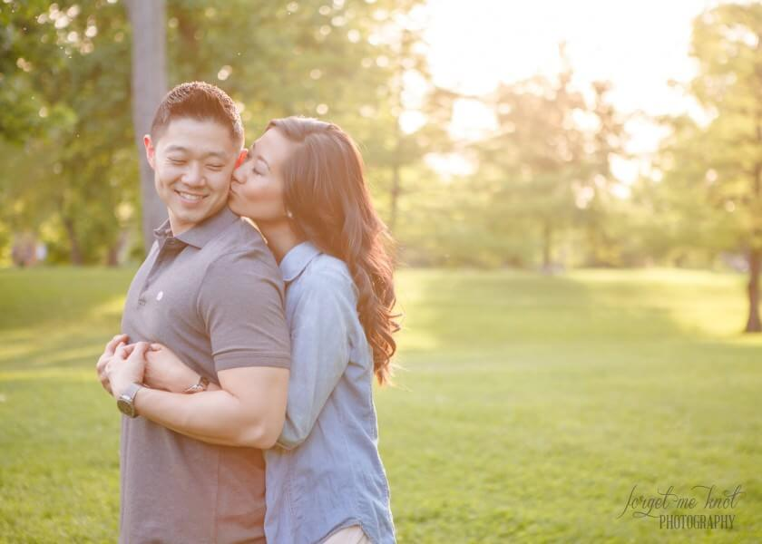 bride to be kissing fiance on cheek at columbus ohio photography engagement