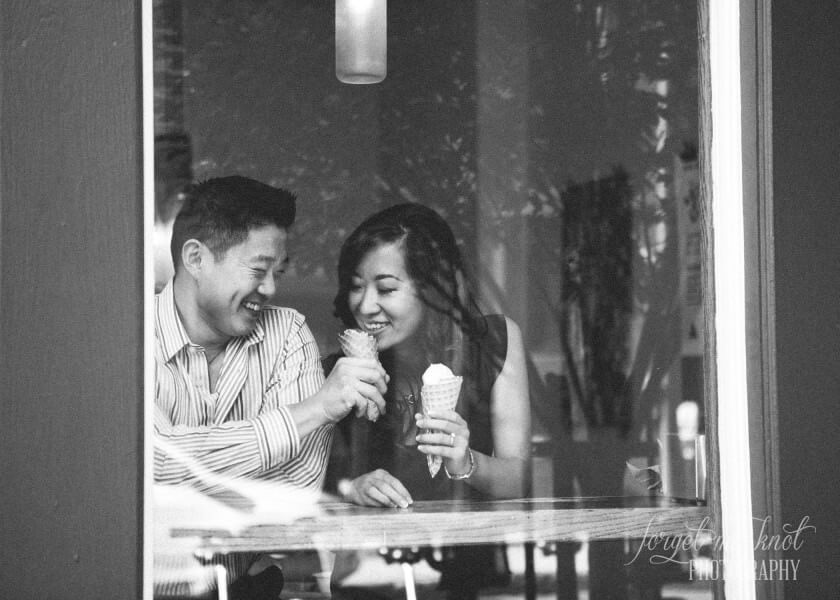 groom to be giving his fiance a taste of his ice cream