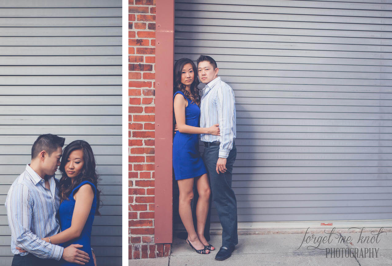 engaged couple standing in front of metal garage doors at columbus ohio photography engagement