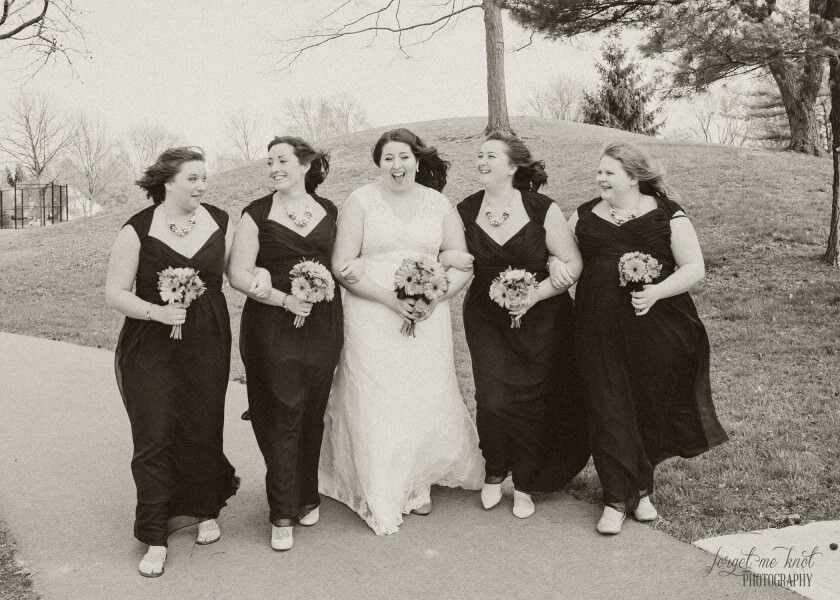 black and white photo of bride with bridesmaids