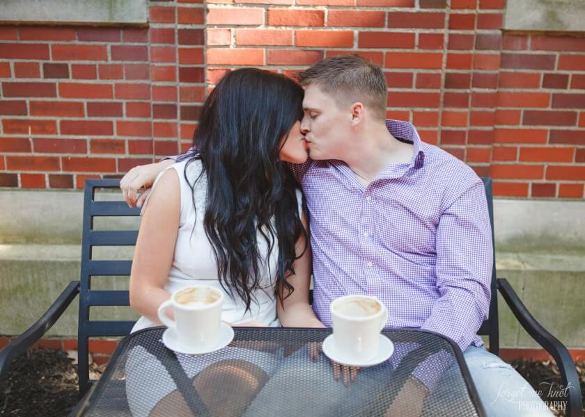 engaged couple kissing at java central in westerville