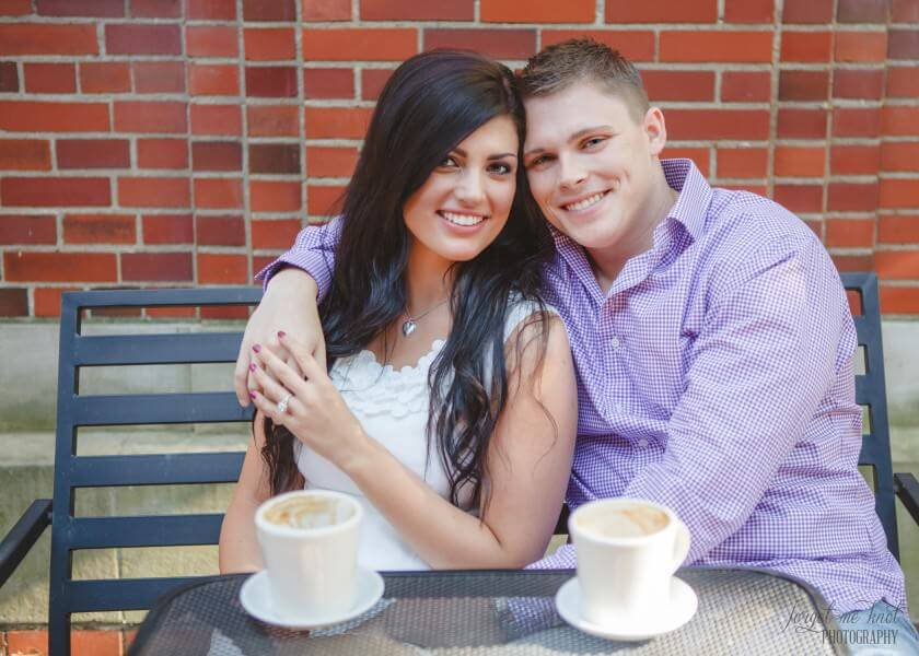 engaged couple sitting having coffee at java central in westerville ohio