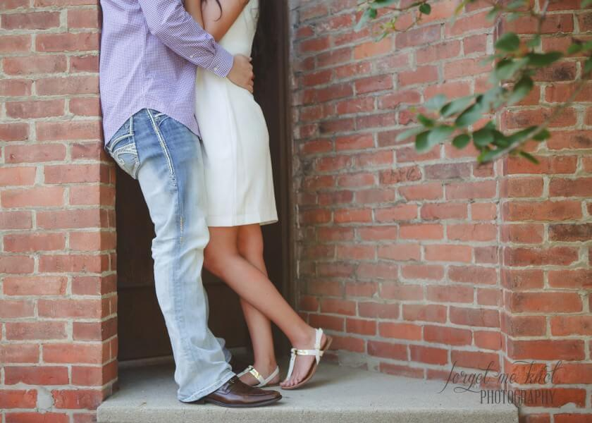 close up of engaged couple with arms around each other