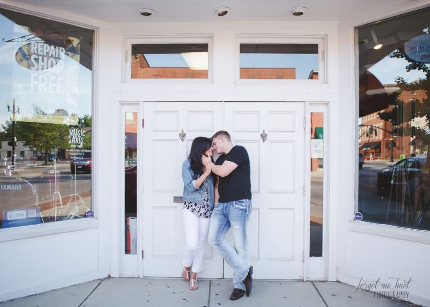 engaged couple in front of white doorway in westerville ohio