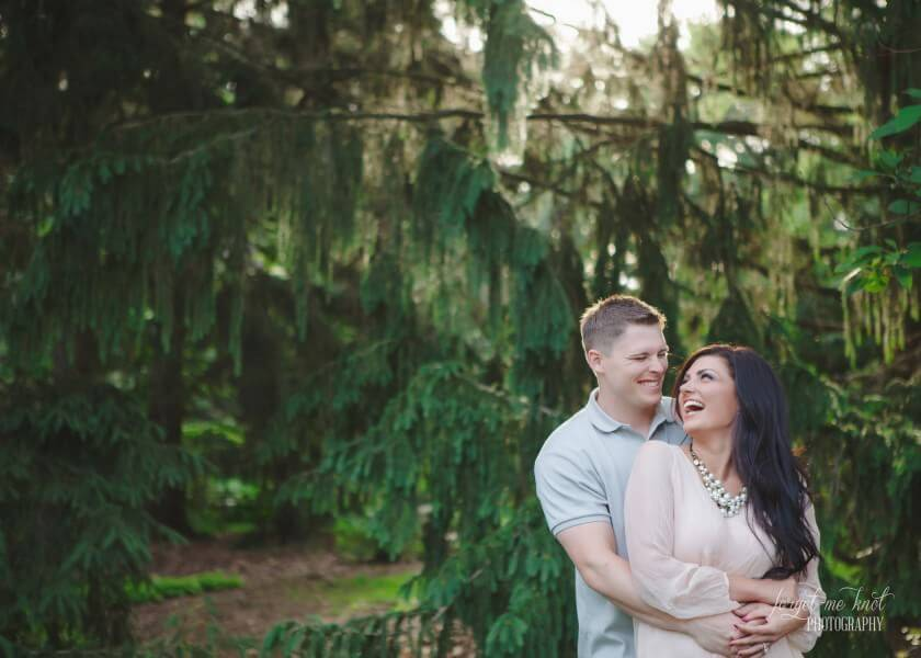 laughing couple at Inniswood Metro Gardens during vintage engagement