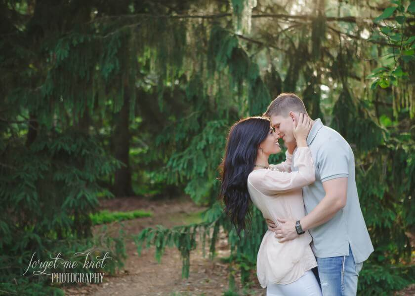engaged couple with foreheads together at Inniswood