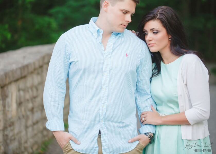 groom to be looking at fiance at vintage engagement session