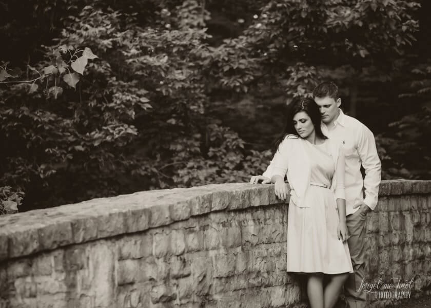 black and white vintage engagement photography of couple looking down