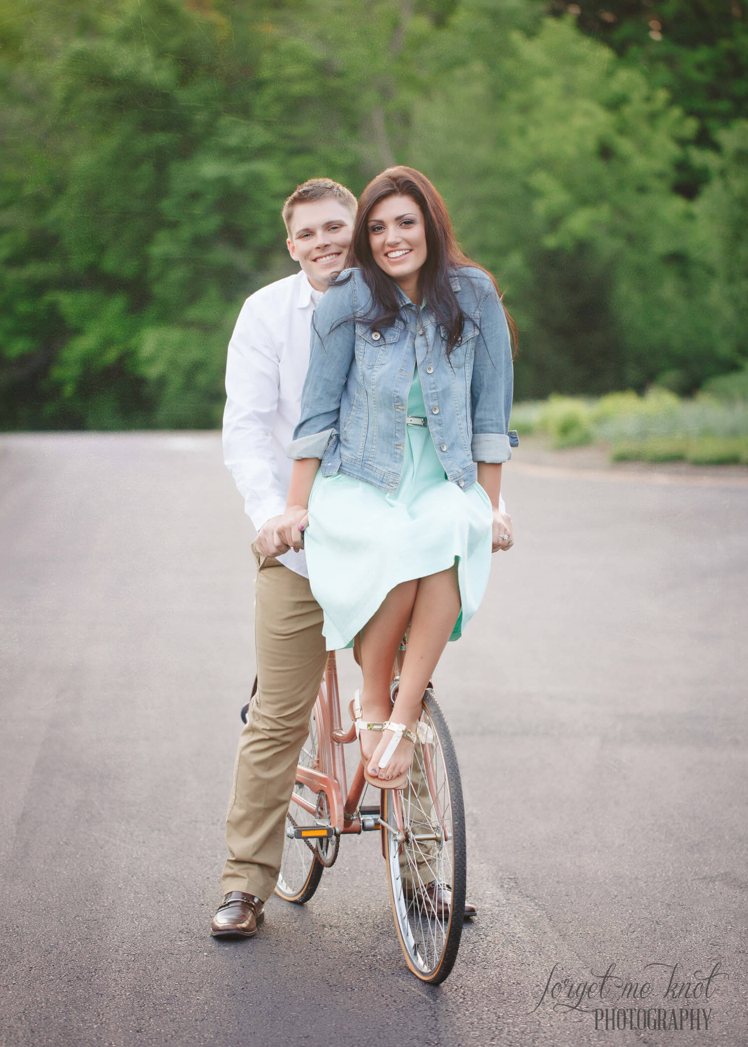 bride to be on handle bars of vintage bicycle at Inniswoods