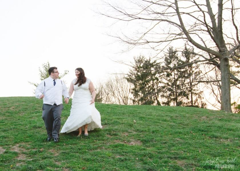 couple running down a hill