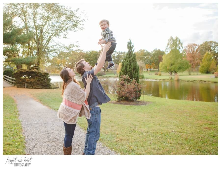 engaged couple playing with son