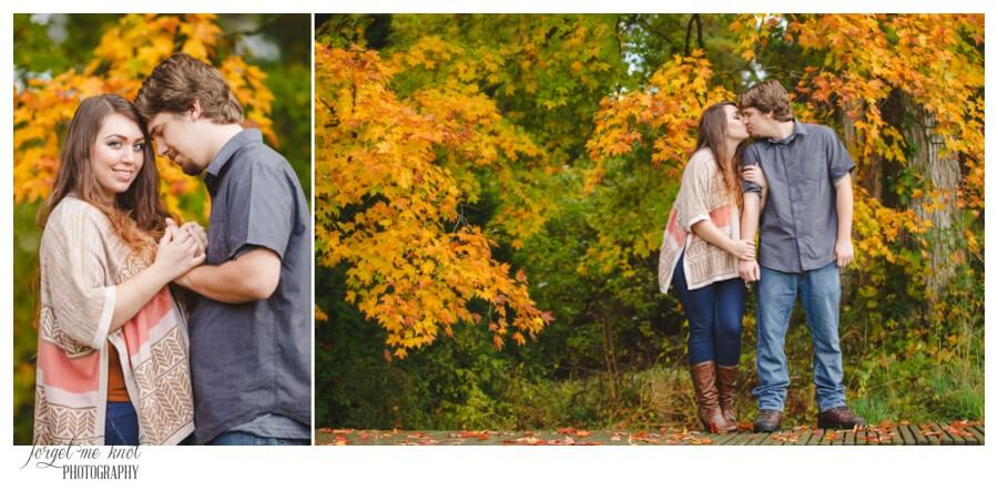engaged couple holding hands and kissing at Dawes Arboretum