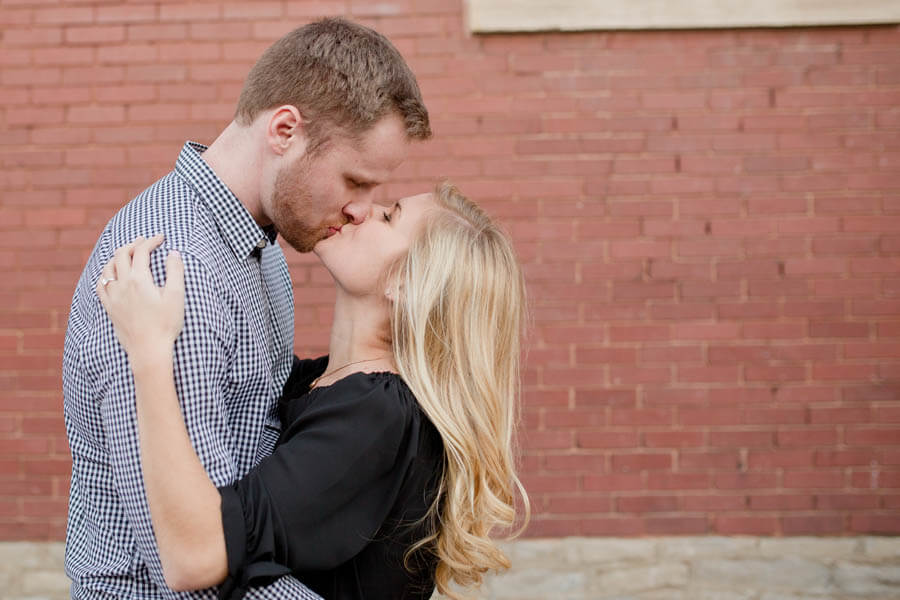 engagement photo of couple kissing in short north