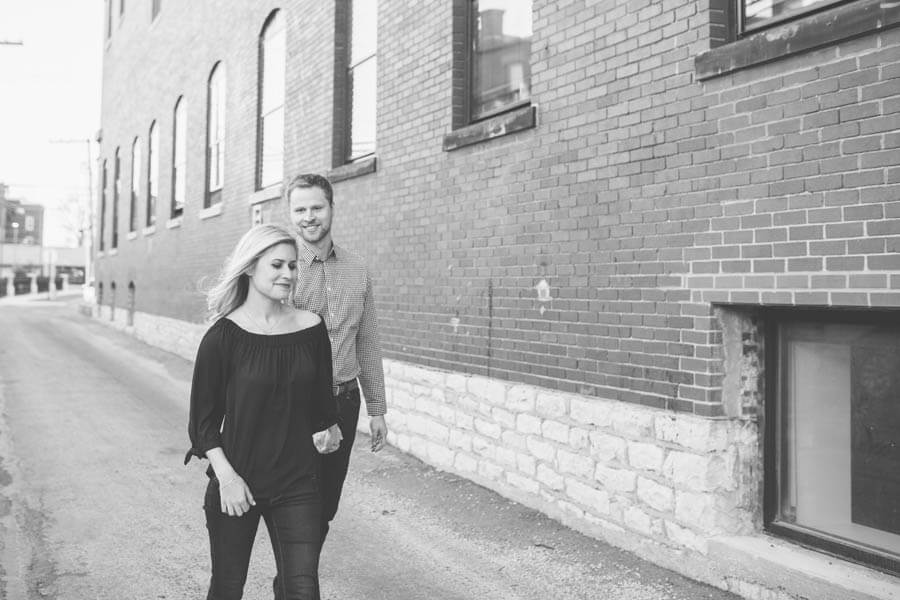 engagement photo of couple in short north walking
