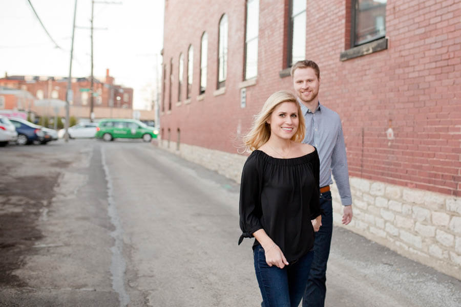 engagement photo of couple walking in short north