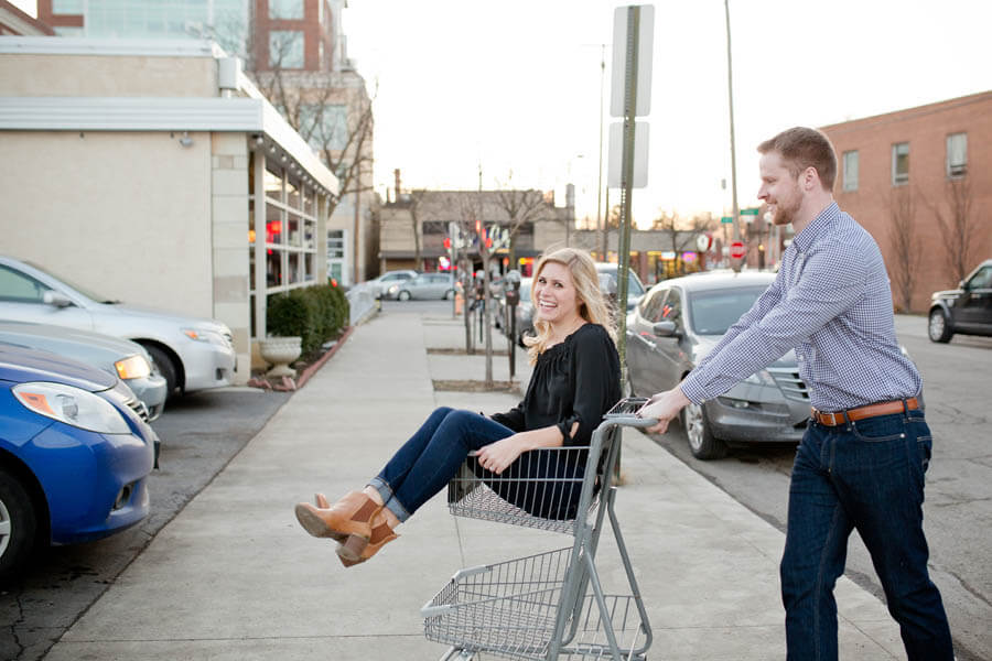 engagement photo of couple in grocery cart