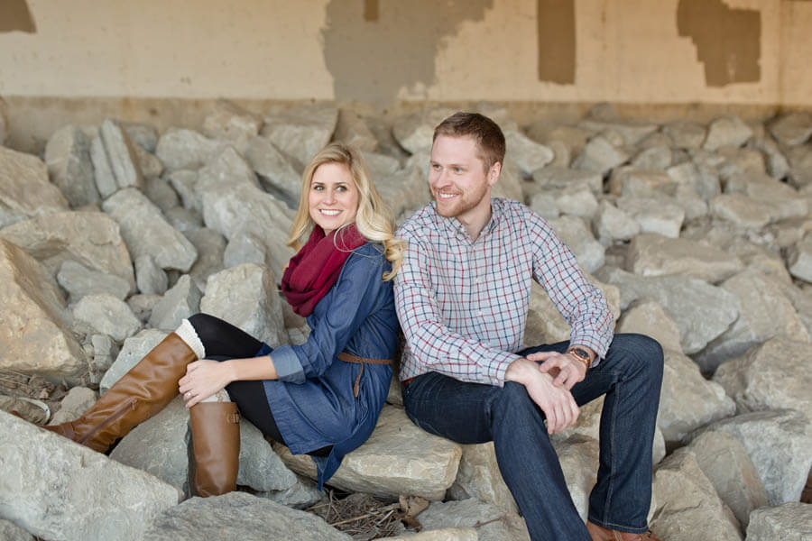 engagement photo of couple laughing under overpass in short north