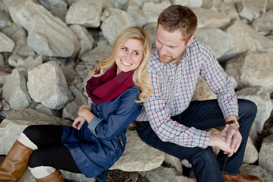 engagement photo of couple smiling under overpass in short north