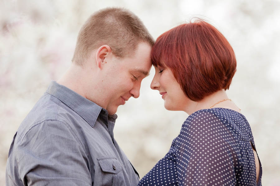 engagement photo of couple with foreheads together