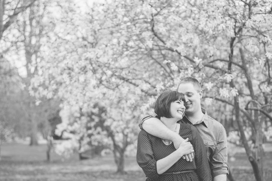 engagement photo of couple laughing at goodale park