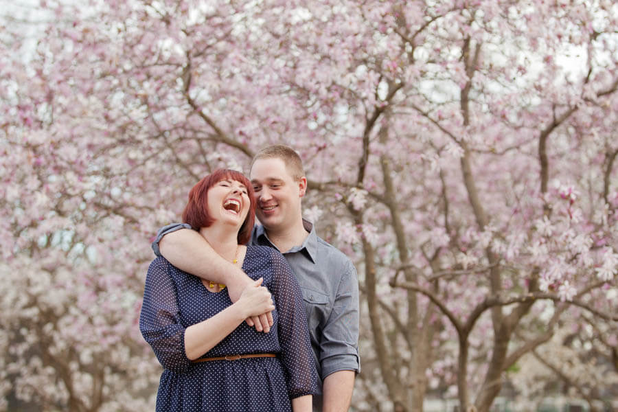 engagement photo of couple laughing at goodale park columbus ohio