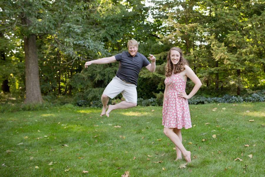 engaged couple jumping at Inniswood Metro Gardens