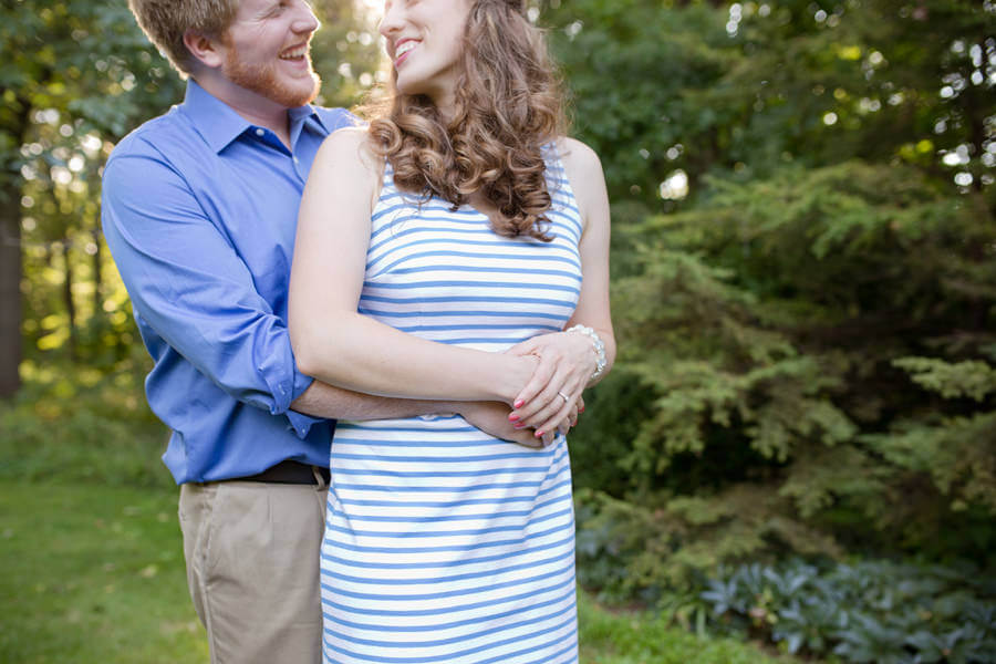 engaged couple smiling at each other