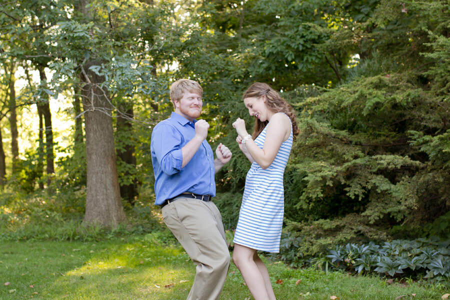 engaged couple dancing in middle of park