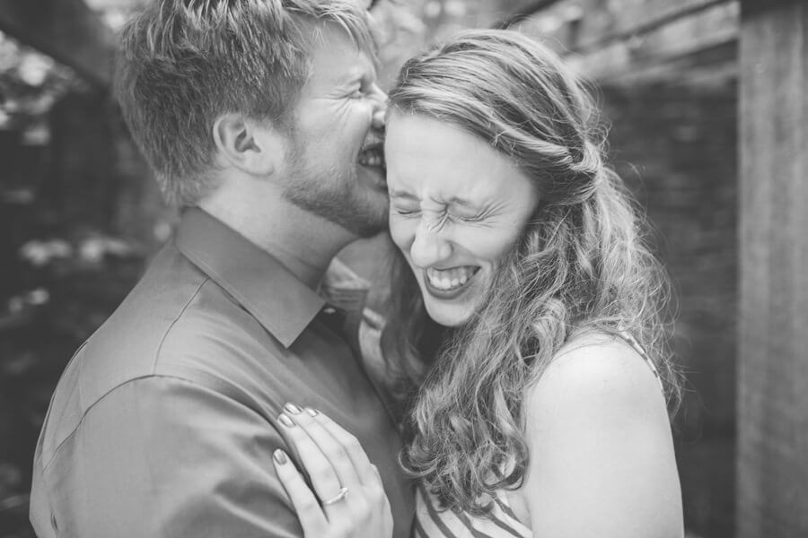 engagement photo of couple laughing at Inniswood Metro Park