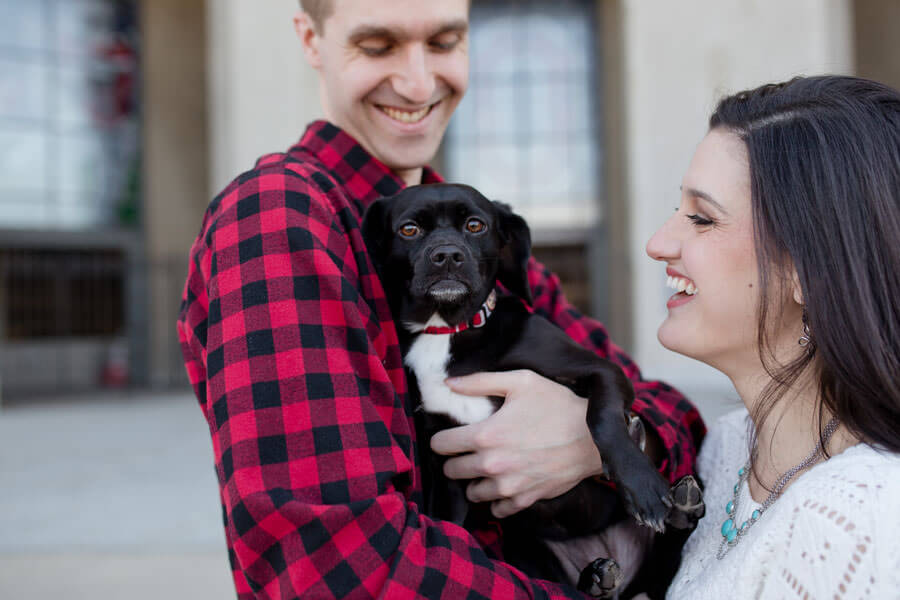 engagement photo of couple with their dog at Ohio State University stadium