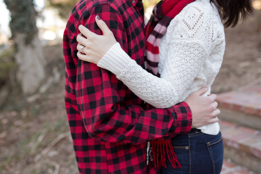 engagement photo of couple hugging at Ohio State University