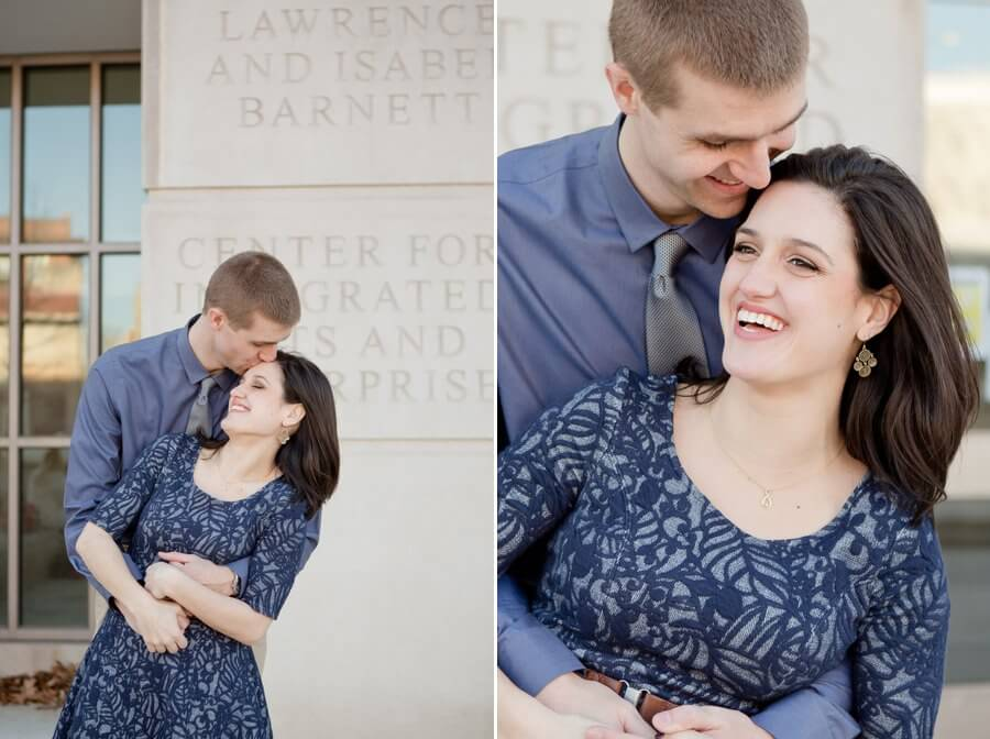 engagement photo of couple kissing and laughing at Ohio State University