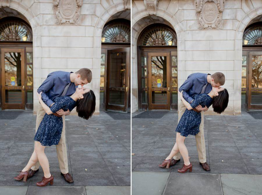 engagement photo of couple kissing at Ohio State University library