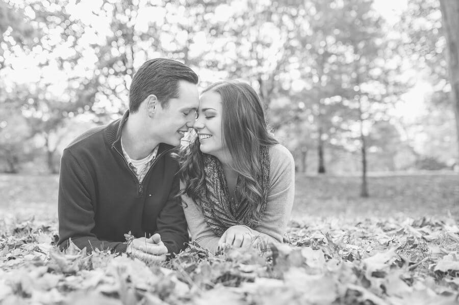engagement photo of couple snuggling at goodale park