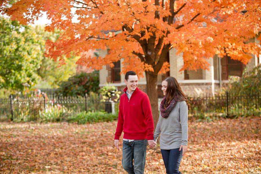 engaged couple walking in goodale park