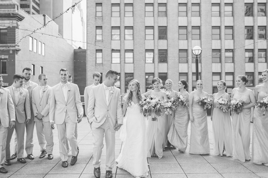 wedding party walking at downtown columbus renaissance