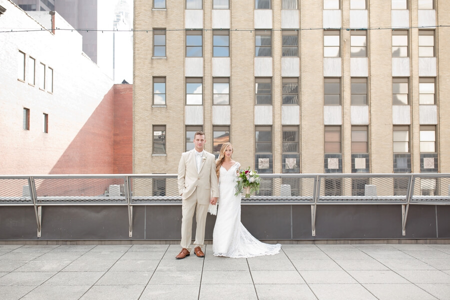 bride and groom holding hands at the renaissance downtown columbus ohio