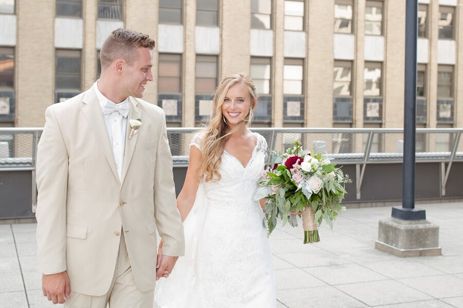 bride and groom walking holding hands at the renaissance columbus ohio