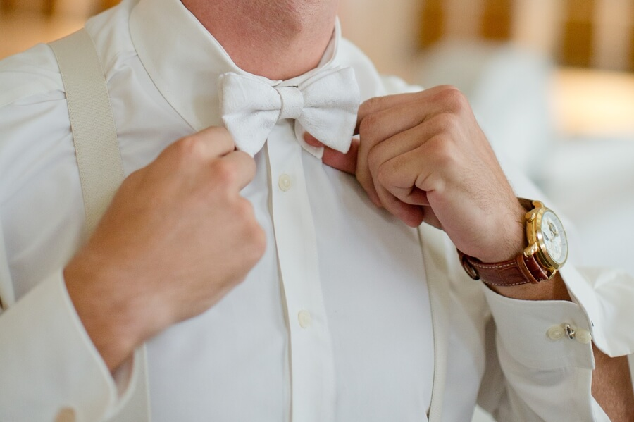 groom putting on bow tie at the Vault Columbus
