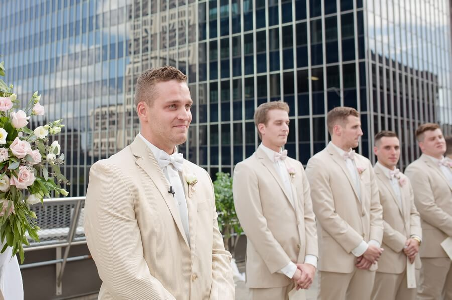 grooms first look of bride walking down aisle at the renaissance columbus