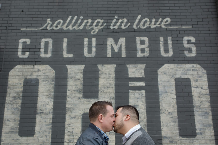 grooms kissing at Pins Mechanical Columbus Ohio