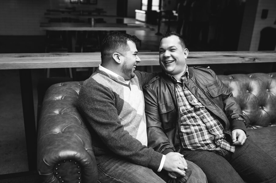 laughing grooms on couch at Pins Columbus