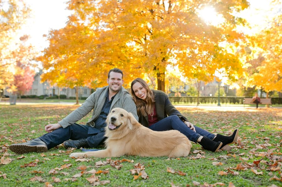 engaged couple at park with dog